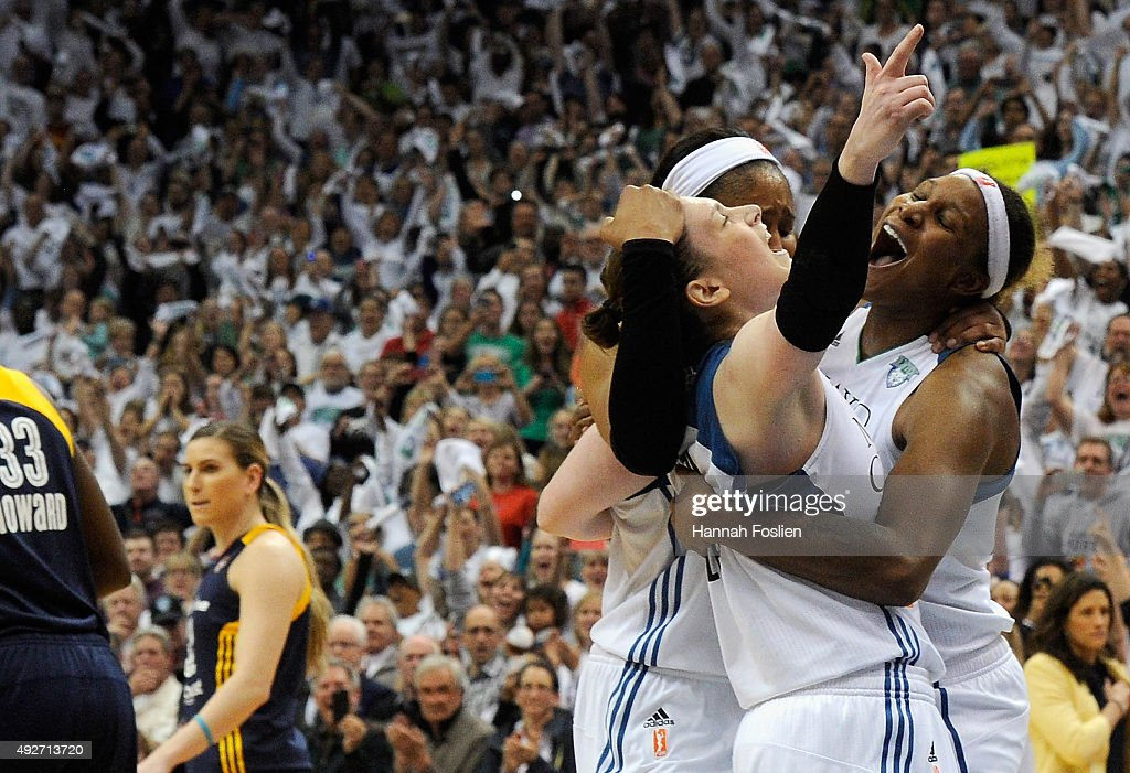Lindsay Whalen #13, Maya Moore #23 and Sylvia Fowles #34 of the Minnesota Lynx celebrate a win in Game Five of the 2015 WNBA Finals against the Indiana Fever on October 14, 2015 at Target Center in Minneapolis, Minnesota. The Lynx defeated the Fever 69-52 to win the WNBA Championship.