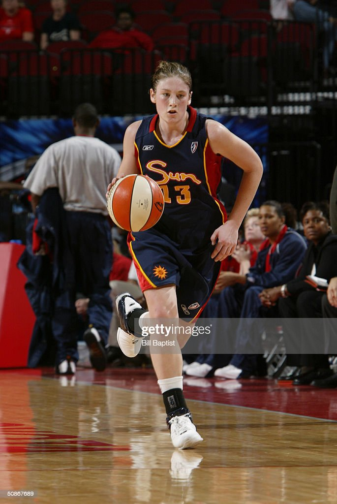 Lindsay Whalen #13 of the Connecticut Sun advances the ball upcourt against the Houston Comets during the preseason game at Toyota Center on May 11, 2004 in Houston, Texas. The Comets won 84-71.