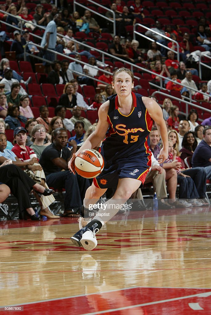 Lindsay Whalen #13 of the Connecticut Sun dribble drives to the basket against the Houston Comets during the preseason game at Toyota Center on May 11, 2004 in Houston, Texas. The Comets won 84-71.