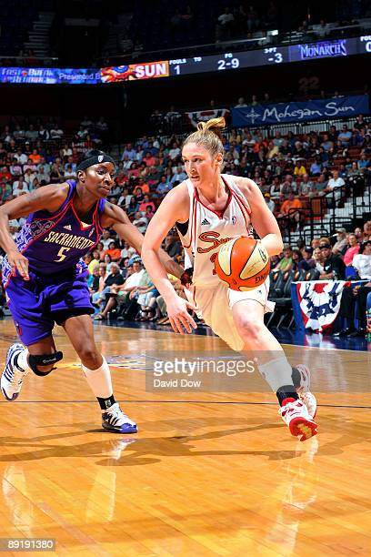 Lindsay Whalen of the Connecticut Sun drives against Scholanda Robinson of the Sacramento Monarchs during the WNBA game on July 22 2009 at the...