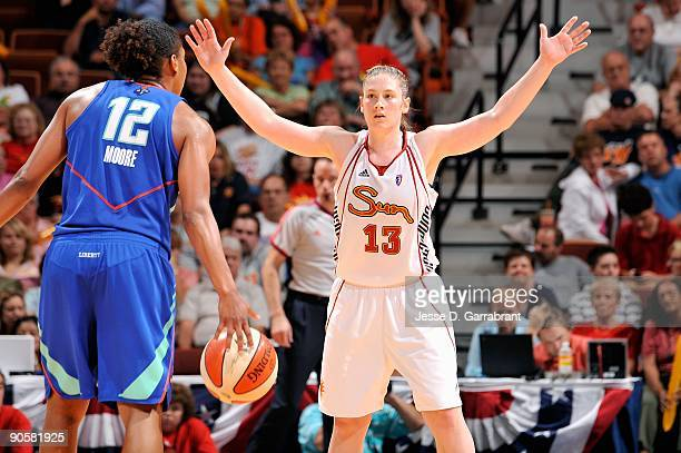 Lindsay Whalen of the Connecticut Sun guards Loree Moore of the New York Liberty during the WNBA game on August 19 2009 at Mohegan Sun Arena in...