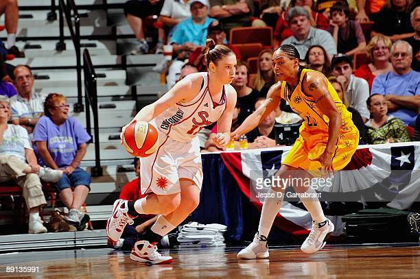 Lindsay Whalen of the Connecticut Sun moves the ball against Betty Lennox of the Los Angeles Sparks during the game on July 14 2009 at Mohegan Sun...