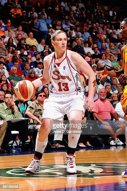 Lindsay Whalen of the Connecticut Sun moves the ball against the Los Angeles Sparks during the game on July 14 2009 at Mohegan Sun Arena in...