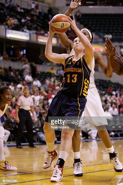 Lindsay Whalen of the Connecticut Sun scores on Tammy SuttonBrown of the Indiana Fever at Conseco Fieldhouse on August 28 2008 in Indianapolis...