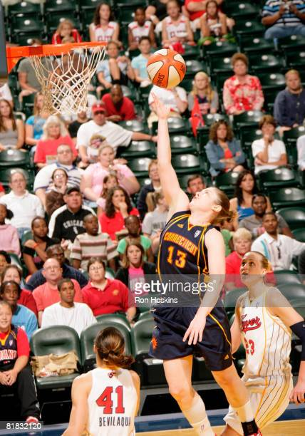 Lindsay Whalen of the Connecticut Sun shoots over Tully Bevilaqua and Katie Douglas of the Indiana Fever at Conseco Fieldhouse on July 5 2008 in...