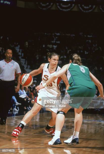 Lindsay Whalen of the Connecticut Suns drives the ball against Kristi Harrower of the Minnesota Lynx during a game on June 30 2005 at Mohegan Sun...