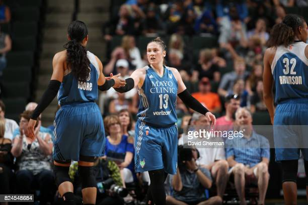 Lindsay Whalen of the Minnesota Lynx and Maya Moore of the Minnesota Lynx high five during the game against the Seattle Storm on July 30 2017 at Xcel...