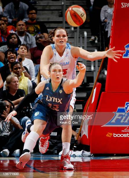 Lindsay Whalen of the Minnesota Lynx battles for a rebound against Alison Bales of the Atlanta Dream in Game Three of the 2011 WNBA Finals at Philips...