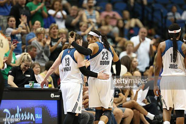 Lindsay Whalen of the Minnesota Lynx celebrates with Maya Moore of the Minnesota Lynx against the Chicago Sky on July 17 2015 at Target Center in...