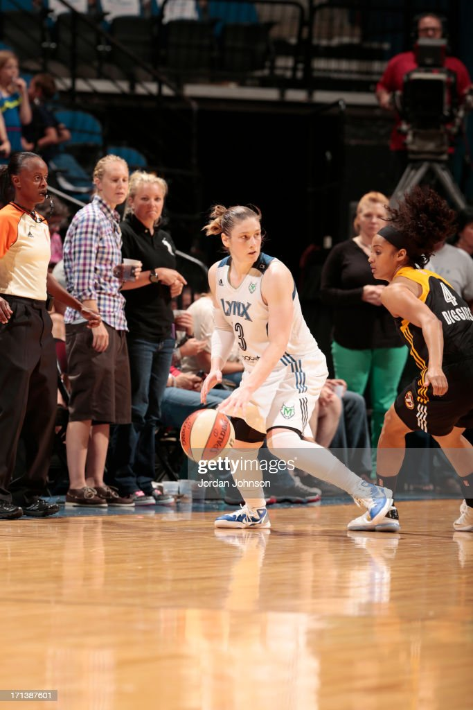 Lindsay Whalen #13 of the Minnesota Lynx dribbles against Skylar Diggins #4 of the the Tulsa Shock during the WNBA game on June 23, 2013 at Target Center in Minneapolis, Minnesota.
