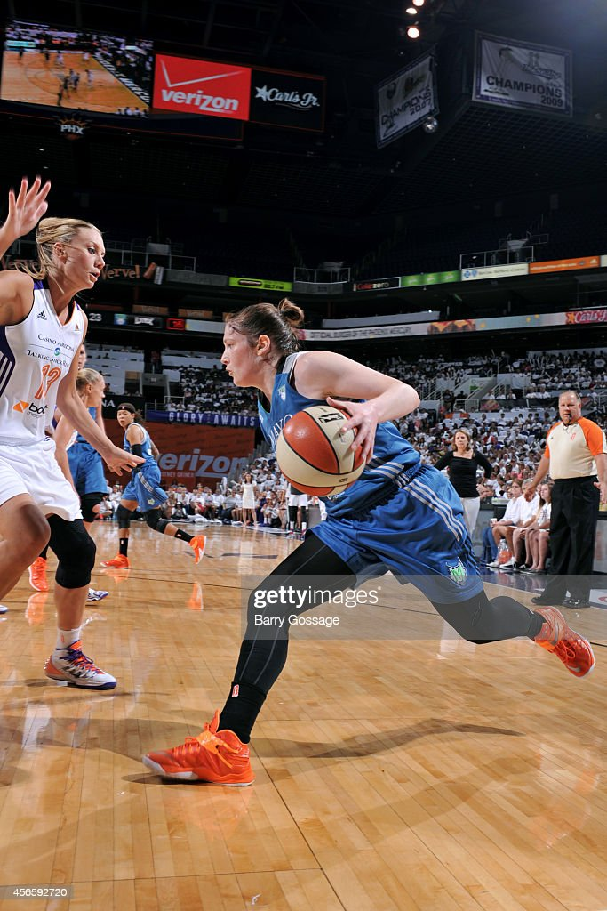Lindsay Whalen #13 of the Minnesota Lynx drives against the Phoenix Mercury in Game 1 of the 2014 WNBA Western Conference Finals on August 29, 2014 at US Airways Center in Phoenix, Arizona.