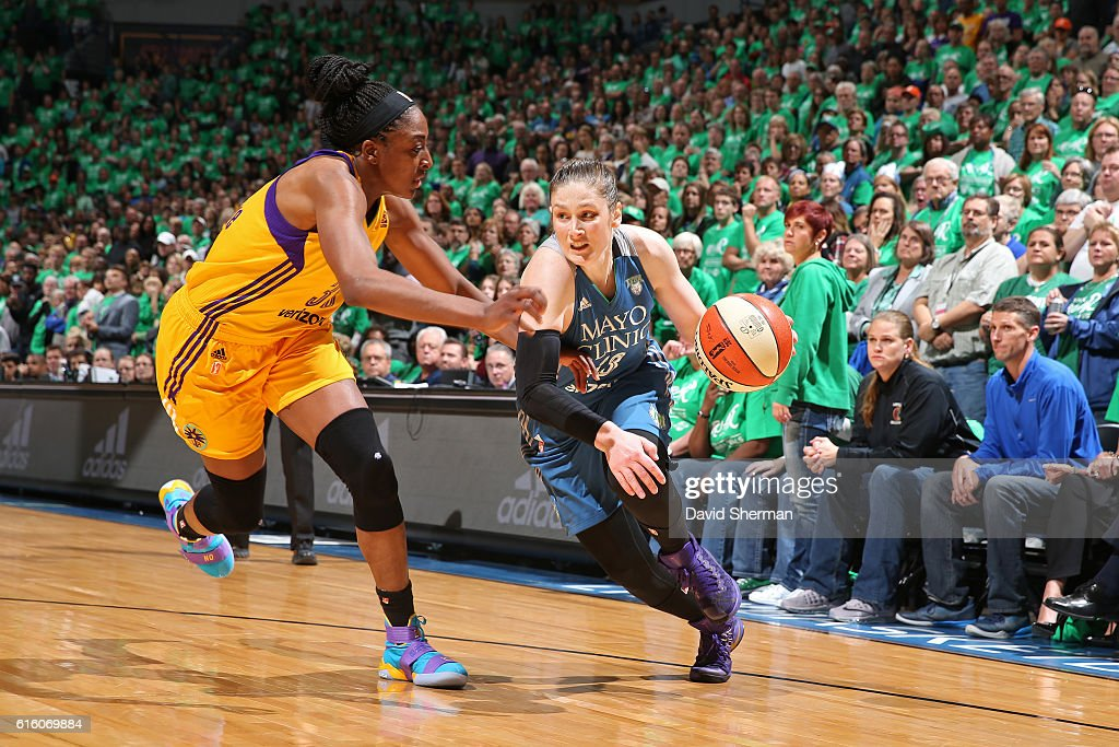 Lindsay Whalen #13 of the Minnesota Lynx drives to the basket against Nneka Ogwumike #30 of the Los Angeles Sparks during Game Five of the 2016 WNBA Finals on October 20, 2016 at Target Center in Minneapolis, Minnesota.