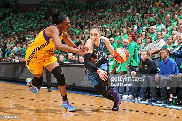 Lindsay Whalen of the Minnesota Lynx drives to the basket against Nneka Ogwumike of the Los Angeles Sparks during Game Five of the 2016 WNBA Finals...