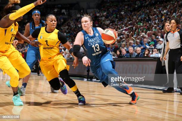 Lindsay Whalen of the Minnesota Lynx drives to the basket against the Los Angeles Sparks on May 20 2018 at Target Center in Minneapolis Minnesota...