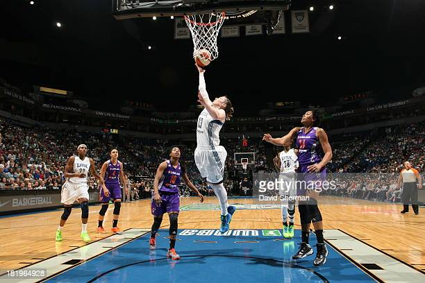 Lindsay Whalen of the Minnesota Lynx drives to the basket and shoots against Jasmine James and Krystal Thomas of the Phoenix Mercury during the WNBA...
