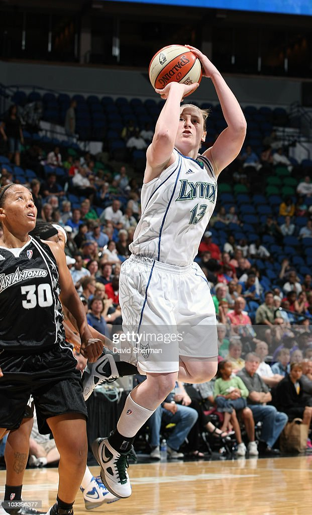 Lindsay Whalen #13 of the Minnesota Lynx goes up for the shot against Helen Darling #30 of the San Antonio Silver Stars during the game on August 15, 2010 at the Target Center in Minneapolis, Minnesota.