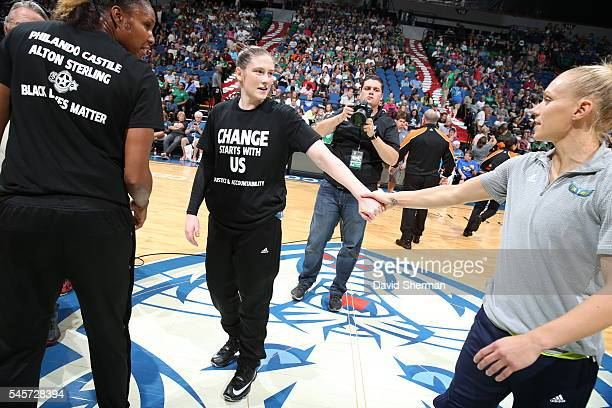 Lindsay Whalen of the Minnesota Lynx greets Erin Phillips of the Dallas Wings before the game during a WNBA game on July 9 2016 at Target Center in...
