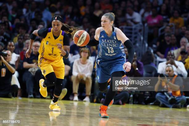 Lindsay Whalen of the Minnesota Lynx handles the ball against Odyssey Sims of the Los Angeles Sparks in Game Three of the 2017 WNBA Finals on...