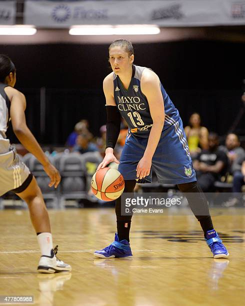 Lindsay Whalen of the Minnesota Lynx handles the ball against the San Antonio Stars at the Freeman Coliseum in San Antonio TX on June 19 2015 in San...
