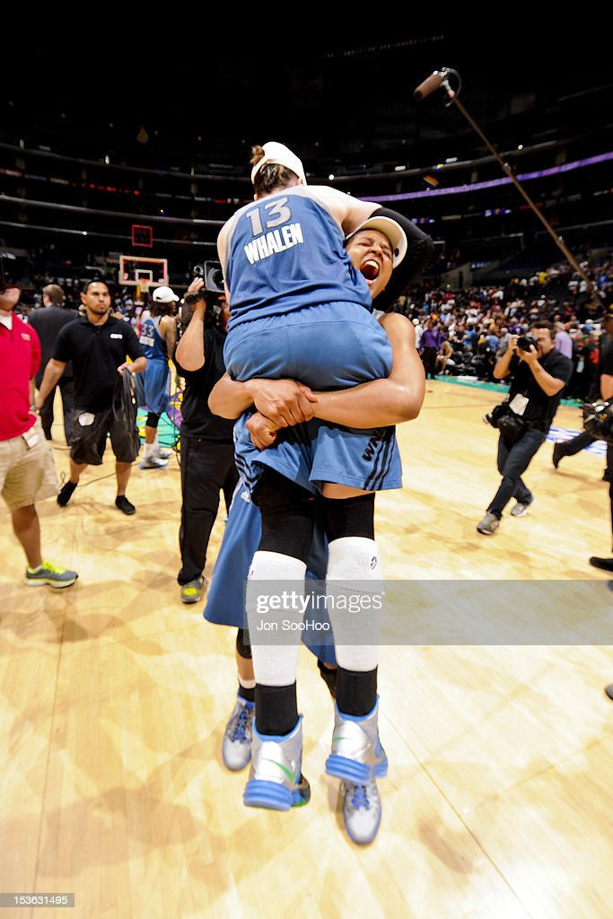 Lindsay Whalen #13 of the Minnesota Lynx hugs a teammate after their team won the WNBA Western Conference Finals against the Los Angeles Sparks at Staples Center on October 7, 2012 in Los Angeles, California.