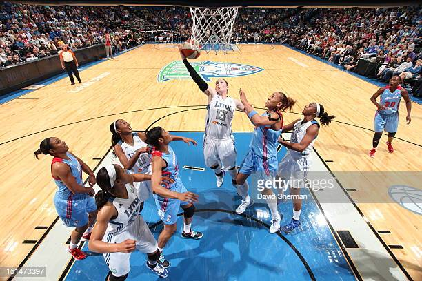 Lindsay Whalen of the Minnesota Lynx rebounds the ball against Erika de Souza of the Atlanta Dream during the WNBA game on September 7 2012 at Target...