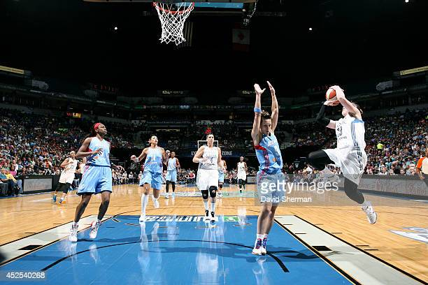 Lindsay Whalen of the Minnesota Lynx shoots against Celine Dumerc of the Atlanta Dream during the WNBA game on July 22 2014 at Target Center in...