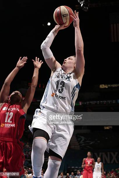 Lindsay Whalen of the Minnesota Lynx shoots against Ivory Latta of the Washington Mystics during the WNBA game on August 8 2013 at Target Center in...