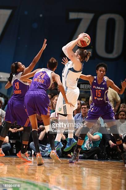 Lindsay Whalen of the Minnesota Lynx takes a shoot against Jasmine James DeWanna Bonner and Briana Gilbreath of the Minnesota Lynx during the WNBA...
