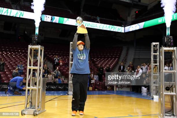 Lindsay Whalen of the Minnesota Lynx walks out holding the 2017 WNBA Championship trophy during the Minnesota Lynx title parade on October 5 2017 at...