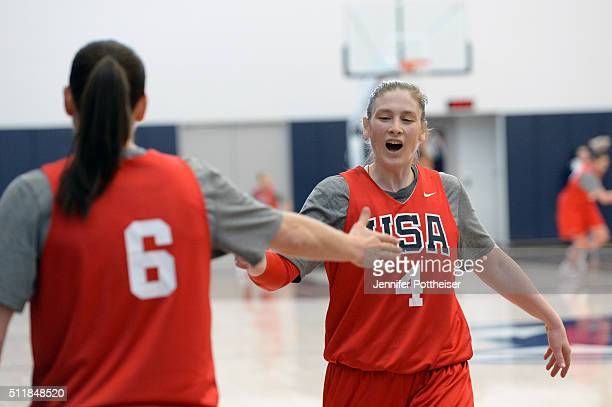 Lindsay Whalen of the USA Women's National Team high fives her teammate during training camp at the University of Connecticut in Storrs Connecticut...