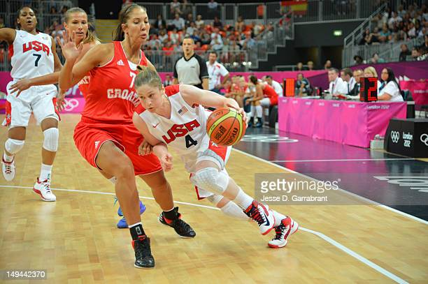 Lindsay Whalen of the USA Women's Senior National team drives against Lisa Ann Karcic of Croatia at the Olympic Park Basketball Arena during the...