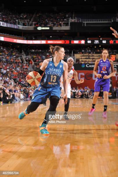 Lindsay Whalen of the Western Conference AllStars dribbles during the 2014 Boost Mobile WNBA AllStar Game on July 19 2014 at US Airways Center in...