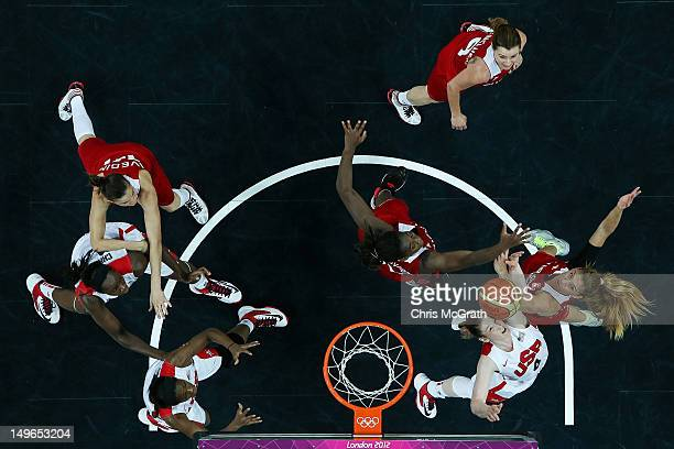 Lindsay Whalen of United States and Bahar Caglar of Turkey compete for a rebound in the Women's Basketball Preliminary Round match between the United...