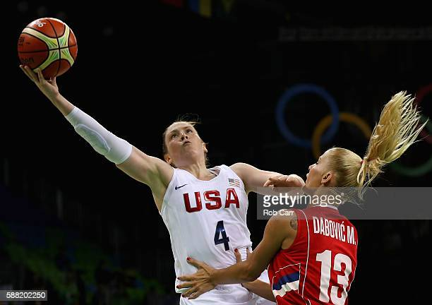 Lindsay Whalen of United States puts up a shot in front of Milica Dabovic of Serbia in the Women's Basketball Preliminary Round Group B match between...