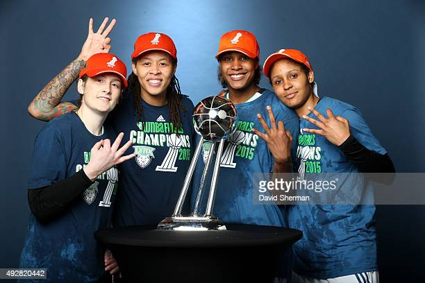 Lindsay Whalen Seimone Augustus Rebekkah Brunson and Maya Moore of the Minnesota Lynx poses with the WNBA trophy after defeating the Indiana Fever in...