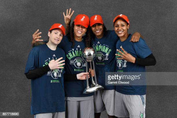 Lindsay Whalen Seimone Augustus Rebekkah Brunson and Maya Moore of the Minnesota Lynx poses for a portrait while holding the 2017 WNBA Championship...