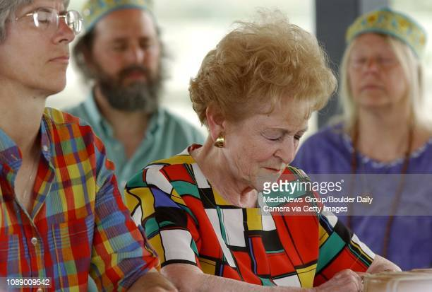 Lindsay Winsor, from Erie, left, Marge Burton, from Seal Beach, California bow their heads and close their eyes during a prayer meeting for rain at...
