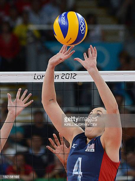 US Lindsey Berg sets the ball during the women's volleyball gold medal match of the London 2012 Olympics Games against Brazil in London on August 11...