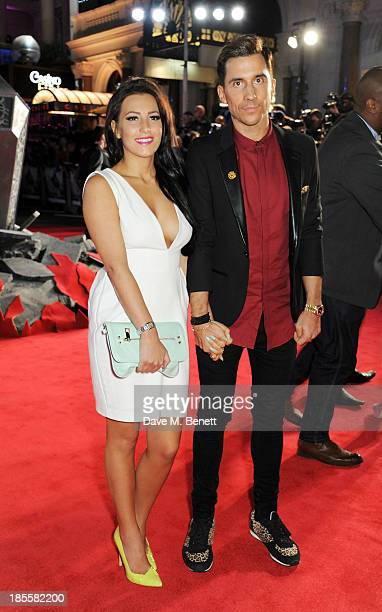 Lindsey Cole and Russell Kane attend the World Premiere of Thor The Dark World at Odeon Leicester Square on October 22 2013 in London England