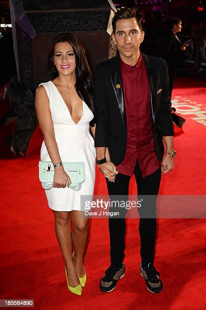 Lindsey Cole and Russell Kane attend the world premiere of Thor The Dark World at The Odeon Leicester Square on October 22 2013 in London England