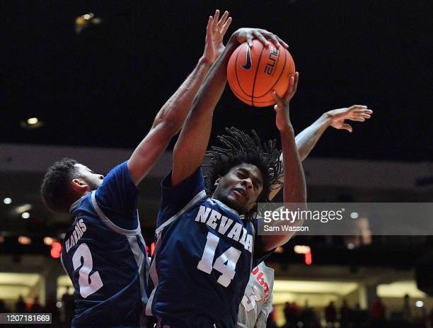 Lindsey Drew of the Nevada Wolf Pack grabs a rebound against Keith McGee of the New Mexico Lobos during their game at Dreamstyle Arena The Pit on...