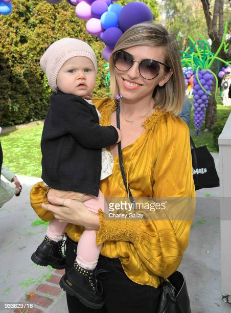 Lindsey Dupuis Bledsoe and Emerson Bledsoe attend AKID Brand's 3rd Annual 'The Egg Hunt' at Lombardi House on March 17 2018 in Los Angeles California