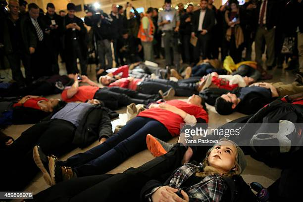 LIndsey Ellefson lies down during a protest in Grand Central Terminal December 3 2014 in New York Protests began after a Grand Jury decided to not...