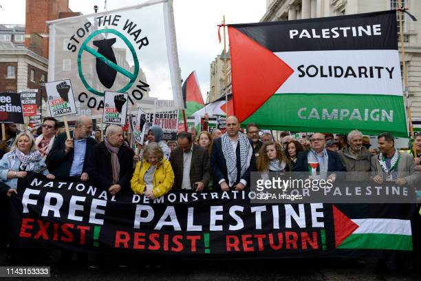 Lindsey German from Stop the War Coalition Palestinian ambassador in UK Husam Zomlot Palestinian humans rights activist Ahed Tamimi are seen marching...