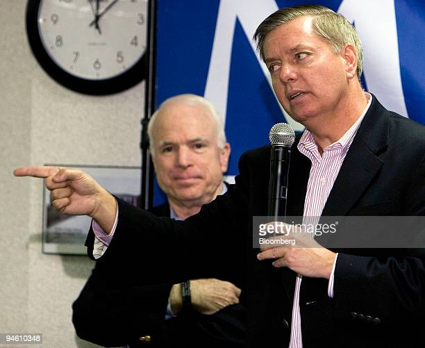 Lindsey Graham US senator from South Carolina right speaks in support of John McCain US senator from Arizona and 2008 Republican presidential...