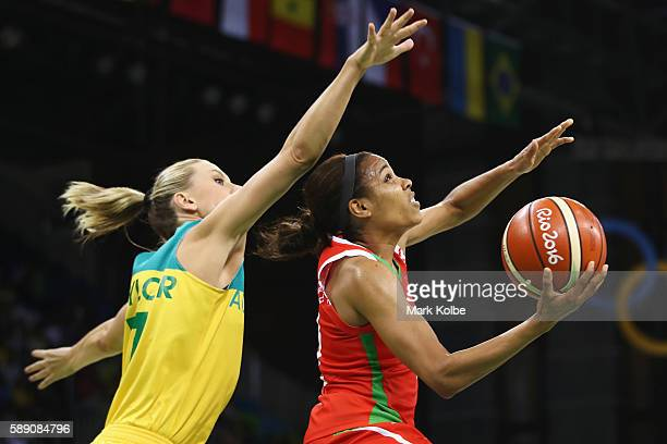 Lindsey Harding of Belarus drives the ball past Penny Taylor of Australia during the Women's round Group A basketball match between Australia and...