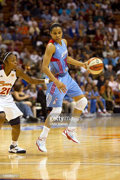 Lindsey Harding of the Atlanta Dream brings the ball up the floor defended by Renee Montgomery of the Connecticut Sun in Game One of the Eastern...