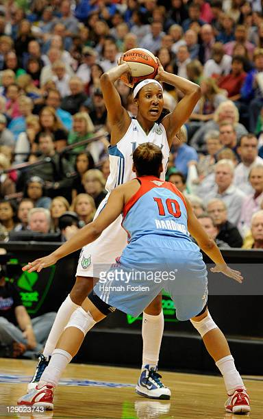 Lindsey Harding of the Atlanta Dream defends as Candice Wiggins of the Minnesota Lynx looks to pass in Game One of the 2011 WNBA Finals on October 2...