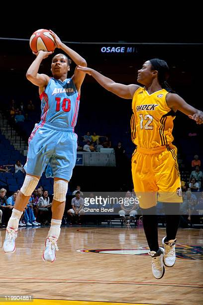 Lindsey Harding of the Atlanta Dream fires a shot just out of the reach of Ivory Latta of the Tulsa Shock during the WNBA game on July 26 2011 at the...