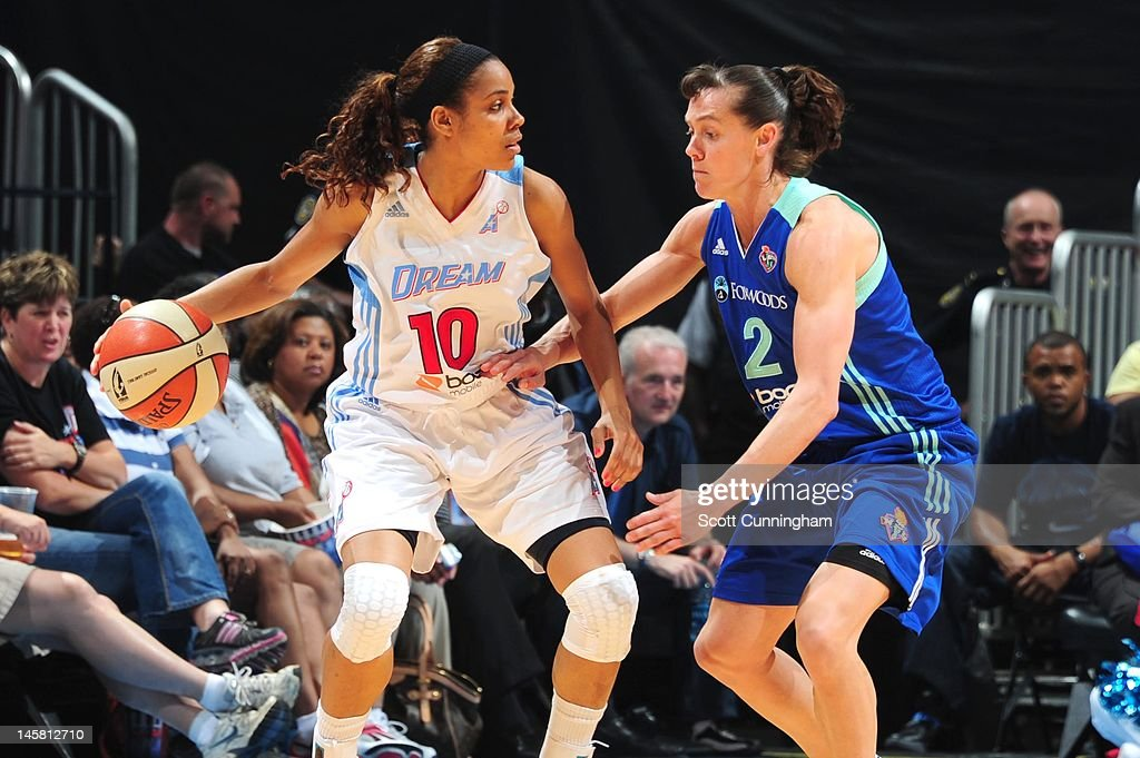 Lindsey Harding #10 of the Atlanta Dream handles the ball against Kelly Miller #2 of the New York Liberty at Philips Arena on May 25, 2012 in Atlanta, Georgia.